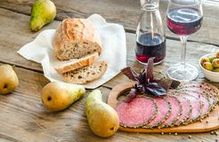 Slices of italian salami with pears and wine Stock Image