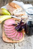 Slices of italian salami with pears and wine Royalty Free Stock Images