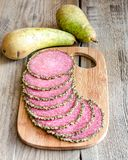 Slices of italian salami with pears Royalty Free Stock Images