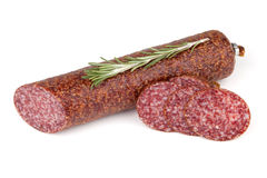 Slices italian salami sausage with rosemary Royalty Free Stock Photography