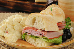 Italian sandwich and potato salad Royalty Free Stock Photography