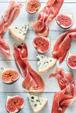 Slices of jamon with blue cheese and figs Stock Image