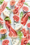 Slices of jamon with blue cheese and figs Royalty Free Stock Image