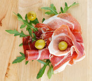 Slices of jamon and olives royalty free stock images