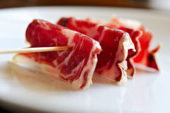 A slices of jamon, strung on a skewer Royalty Free Stock Images