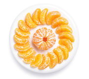 Slices of juicy tangerine Stock Photos