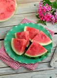 Slices of juicy watermelon on a green plate Stock Photos