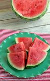 Slices of juicy watermelon on a green plate Stock Images