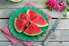 Slices of juicy watermelon on a green plate Royalty Free Stock Photography