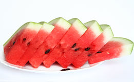 Slices of juicy watermelon served on white plate Stock Images