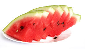 Slices of juicy watermelon served on white plate Stock Photos