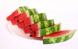 Slices of juicy watermelon served on a white plate Stock Photography