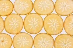 Slices of kaki. Background of backlit kaki slices Stock Photography