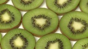 Slices of kiwi fruit closeup stock video footage
