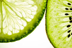 Slices of Kiwi fruit and lime Stock Image