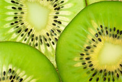 Slices of kiwi fruit (macro). Slices of ripe kiwi fruit (close up,transparent Royalty Free Stock Photography