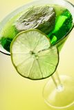 Slices of kiwi and lime. Inside a sparkling ice drink in green tones Stock Photos