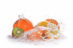 Slices of kiwi,  orange and  lemon. In  water with bubbles Royalty Free Stock Photos