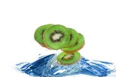 Kiwi splash. Slices of kiwi splashing in water Royalty Free Stock Image