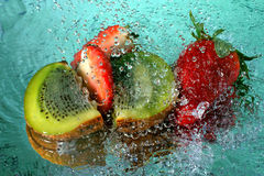 Kiwi and strawberry. Slices of kiwi and strawberry with water drops Royalty Free Stock Images