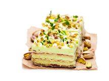 Slices  of layered cake  with pistachio isolated on white. Slices  of layered cake with pistachio isolated on white Stock Photo