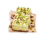 Slices  of layered  cake with pistachio isolated on white. Slices  of layered cake with pistachio isolated on white Stock Image