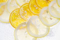 Slices of lemon. And orange on the table royalty free stock photo