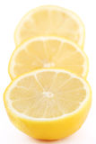 Slices of lemon. Isolated on white Stock Photos