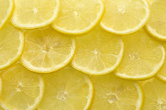 Slices of lemon background Royalty Free Stock Images