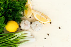 Slices of lemon, garlic cloves and parsley on the white backgrou Stock Image