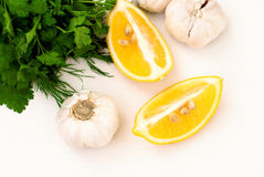 Slices of lemon, garlic cloves and parsley on white background Royalty Free Stock Photo