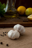 Slices of lemon, garlic cloves and parsley on white background Stock Photography
