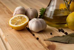 Slices of lemon, garlic cloves and parsley on white background Stock Images