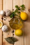 Slices of lemon, garlic cloves and parsley on white background Stock Photo