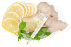 Slices of lemon, ginger and honey with a thermometer Royalty Free Stock Photography