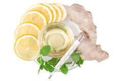 Slices of lemon, ginger and honey with a thermometer Stock Photography