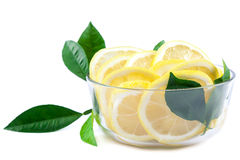 Slices of lemon in a glass bowl Royalty Free Stock Images