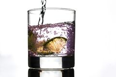 Slices of lemon in a glass of rose water royalty free stock photos