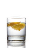 Slices of lemon in glass of water Stock Photos