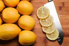 Slices of lemon on a knife. Isolated. Closeup sliced lemon lying on a knife Royalty Free Stock Photo
