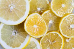 Slices of lemon and orange close-up. Vitamin C in citrus fruits. Fruit yellow background. Slices of lemon and orange close-up. Vitamin C in citrus fruits. Fruit Stock Photography