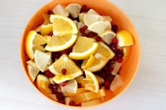 Slices of lemon and orange with cranberries. Slices of lemon and orange mixed with cranberries in a round bowl Stock Photos