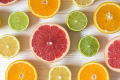 Slices of lemon, orange, lime and grapefruit on white wooden tab Royalty Free Stock Photography