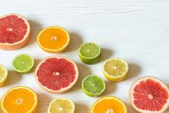 Slices of lemon, orange, lime and grapefruit on white wooden tab Stock Photography