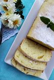 Slices of lemon pound cake on a blue plate Stock Images