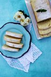 Slices of lemon pound cake on a blue plate Stock Photos