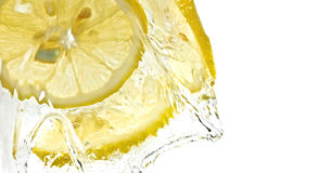 Slices of lemon in water splash. Closeup, isolated, white background Royalty Free Stock Photography