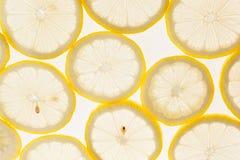 Slices of lemon on a white background. Pattern. Macro. Stock Photos