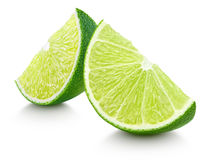 Slices of lime citrus fruit isolated on white Royalty Free Stock Photos