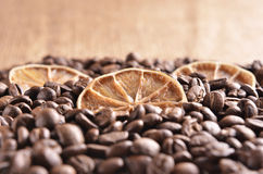 Slices of  lime on the coffee beans Royalty Free Stock Image